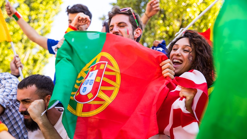 People enjoying holding Portugal flag