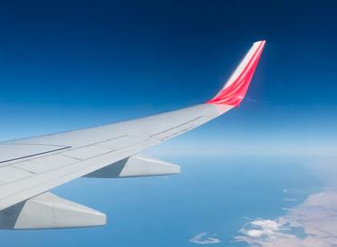 view of plane wing at altitude